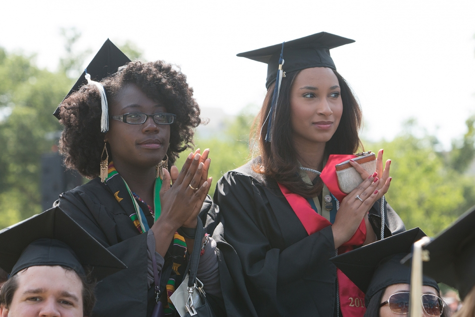 Students clapping at commencement