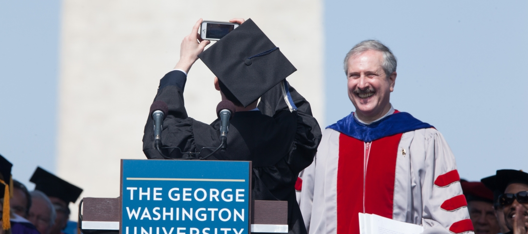 Gabriel Felder taking a selfie on stage before his speech at commencement in 2014