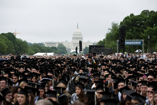 View of graduates sitting in front of the Capitol.